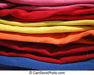 t-shirts - colorful stack of cotton shirts