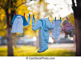 T-shirts hanging on a clothesline in front of blue sky and ...