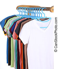 t-shirts hanging on hangers isolated on white background