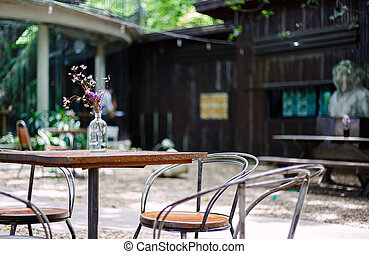 Table and chair are outdoor in the coffee shop.
