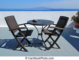 Table and chairs at Santorini, Greece