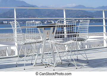 Table and chairs in a beach cafe on the shore near the sea in Batumi, Georgia