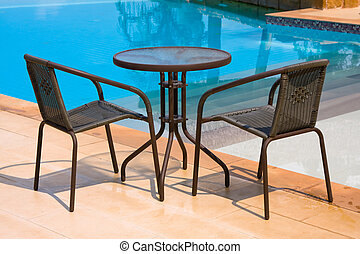 Table and chairs next to the pool