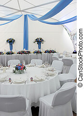 Close up of beautifully laid table at wedding reception.
