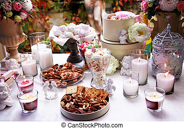 Table beautifully laid for tea - Table with candles...