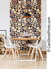 Table by the wall with wallpaper