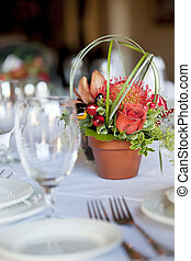 Formal table arrangement with a floral centerpiece