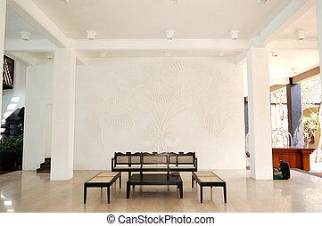 Table, chairs at lobby of popular hotel, Bentota, Sri Lanka