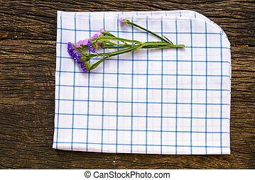 Table Cloth And Flower On Old Wooden Table With Copyspace