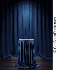 Table covered with blue cloth in interior