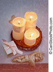 Table decorated with candles and angels for wedding or romantic dinner. Gift box with wedding rings, proposal or marriage concept. Toned photo