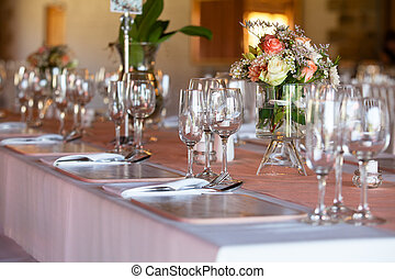 Table decorated with flowers at wedding reception