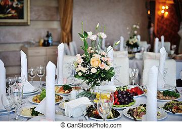 table decorated with flowers wedding dinner