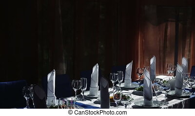 table decoration in the restaurant with food and drinks