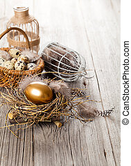table decoration on white wooden background with Chicken golden egg