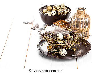 table decoration on white wooden background with quail eggs