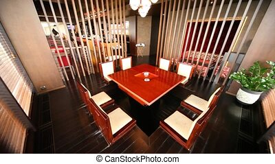 Table for eight persons stand in separate room separated by...