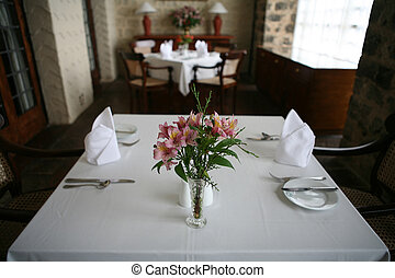 Table for two - Flowers on a table set for two