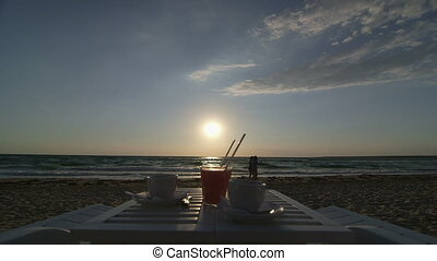 Table for two on summer beach