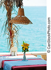 Table in a restaurant by the sea