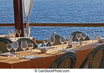 Set table in a waterfront restaurant