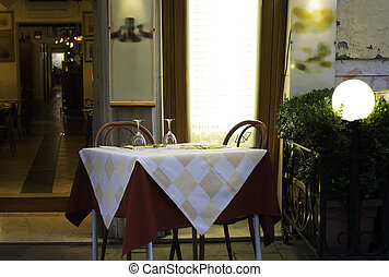 Table in an Italian restaurant. Wooden antique furniture