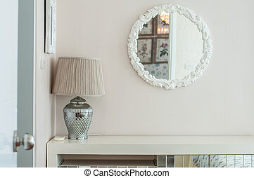 Table lamp and glass on white background