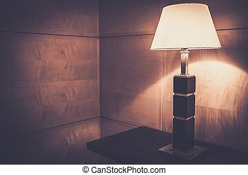 Table lamp in wooden interior