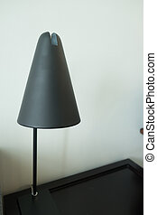 Table lamp is on the table
