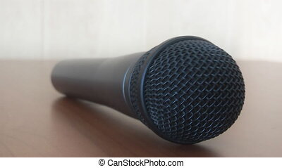 table, microphone, rouleaux