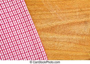 Table napkin - Table kitchen napkin on wooden background.