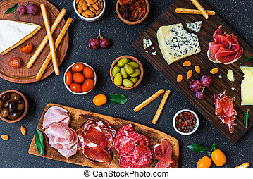 Table of antipasti and appetizers with cold meats and cheese deli platter.