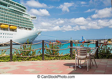 Table on Restaurant Patio with Cruise Ship in Background