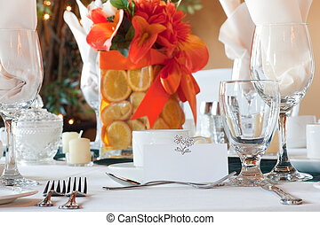 Table place setting with colorful center piece and place...