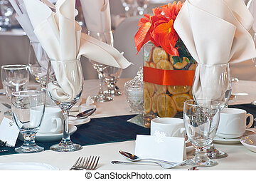 Table place setting with colorful center piece - Closeup of...