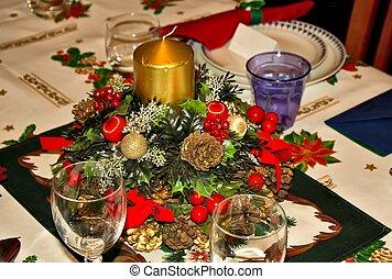 table prepared for Christmas dinner