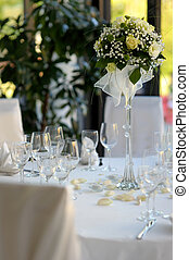 Table set for a festive party or dinner with a rose
