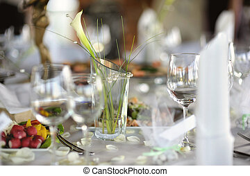 Table set for a festive party or dinner with glasses