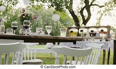 Table set for a garden party or celebration outside. Soft...