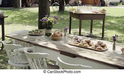 Table set for a garden party or celebration outside. Sweet...