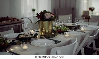 Table set for a meal indoors in a room on a party, a wedding...