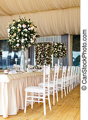 Table set for wedding with a beautiful flowers