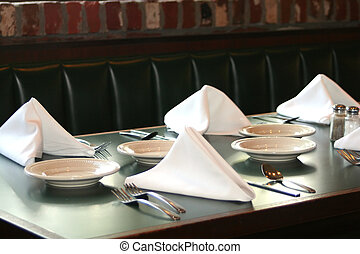 Table Set - Restaurant table set with plates, utensils and...