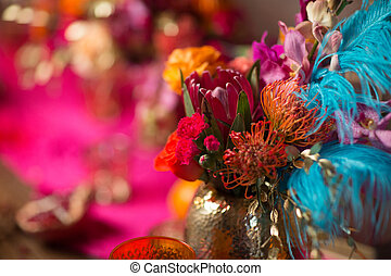 flowers in a vase in a pink and purple background