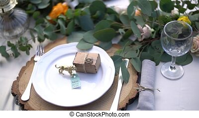 table setting at a wedding banquet decorated with flowers. High quality FullHD footage
