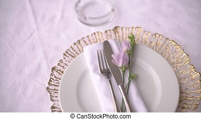 table setting at a wedding banquet decorated with lisianthus flowers. High quality FullHD footage