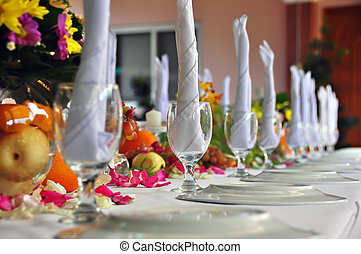 Close up of formal place setting. Focus on second goblet and plate