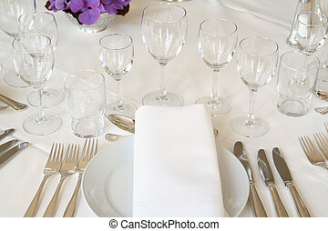 table setting for fine dining or party. cutlery and plate inrestaurant set up for wedding celebration