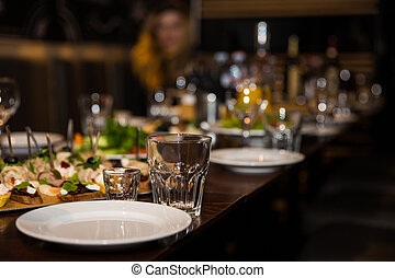 Table setting decor with cutlery, plates and glasses on reception background