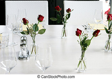 Table setting - Elegant table setting with vases of red...
